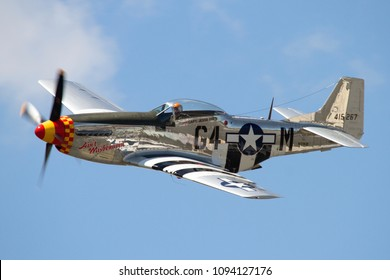 YPSILANTI, MICHIGAN / USA - August 4, 2012: A World War II era P-51 Mustang performs at the 2012 Thunder Over Michigan Airshow.