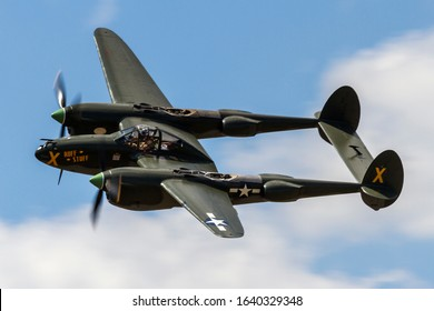 Ypsilanti, Michigan / USA - August 4, 2012: A World War II era P-38 Lightning performing at the 2012 Thunder Over Michigan Airshow.