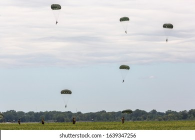 YPSILANTI, MICHIGAN / USA - September 2, 2017: A massive World War II paratrooper drop re-enactment at the 2019 Thunder Over Michigan Airshow.
