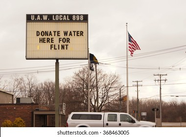 YPSILANTI, MI/USA Jan. 27, 2016: Sign at UAW local asking for donations for the Flint water crisis. The water in Flint has high levels of lead causing a health crisis.