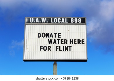 YPSILANTI, MI/USA MARCH 16, 2016: Sign at UAW local asking for donations for the Flint water crisis. The water in Flint has high levels of lead causing a health crisis.