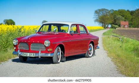 YSANE, SWEDEN - MAJ 21: Summer portrait of Swedish retro car on country road in Southern Sweden, in Maj 21, 2017. The Volvo Amazon was a mid-size car manufactured by Volvo Cars from 1956 to 1970.