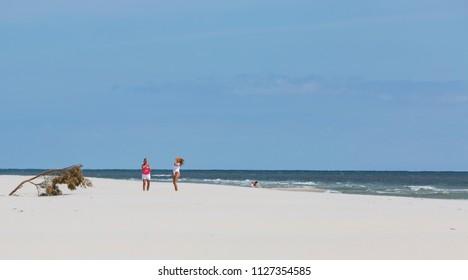 YSTAD, SWEDEN - JUNE 14, 2018: Mother and daughter in a photo session on the beach of Sandhammaren, Skane Sweden