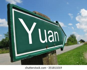 YUAN arrow signpost along a rural road
