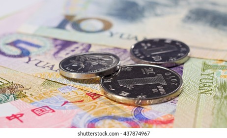 Yuan bank notes and coins business background, shallow depth of field