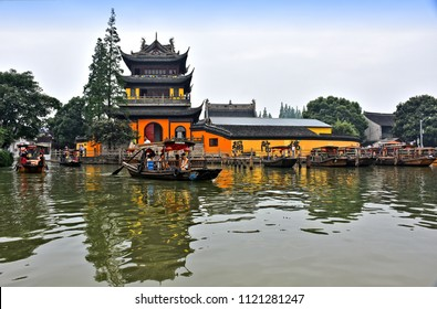 Yuanjin monastery from across  Chaogang river in old water town of Zhujiajiao (Venice of China). Monastery and the town are popular tourist attractions in Shanghai vicinities. Photo taken 2018-05-28