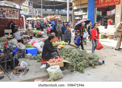 YuanYang, China - February 21, 2017: Hani people buying stuff in the Shengcun local market in YuanYang. Hani are one of the 56 minorities in China and are native of YuanYang in Yunnan.