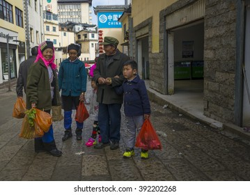 YUANYANG , CHINA, March 01, 2016: People are walking through main street of chinese mountain village bada which is situated among yuanyang rice terraces in yunnan province.