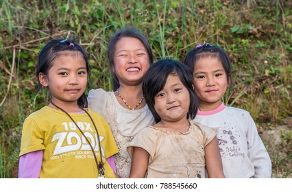 YUANYANG, YUNNAN, CHINA - NOVEMBER 04 2013: Happy Chinese girls in the village of Yunnan Province