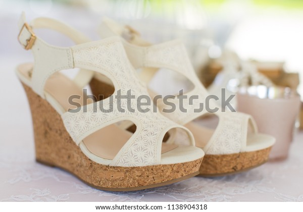 Yuba City, CA - May 23, 2013: Cream colored high heel wedding shoes waiting to be worn by the bride while she is getting ready.