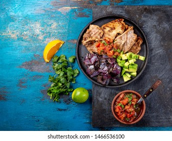Yucatan Mexican Food Pork POC CHUC poc chuck. Pork marinaded in orange juice served with avocado, purple onion and rustic tomato sauce