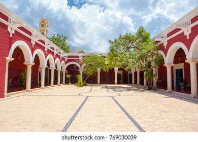 Yucatan, Mexico - 17 May 2017: Architectural detail of the facade and roof of old Yucatan Hacienda at Xcaret park and chapel on the background, Yucatan, Mexico, 17 May 2017