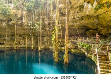 Yucatan, Mexico - October 30, 2014: A young woman preparing to jump in a cenote at San Lorenzo Oxman. Valladolid Cenotes. Yucatan Peninsula. Mexico, America
