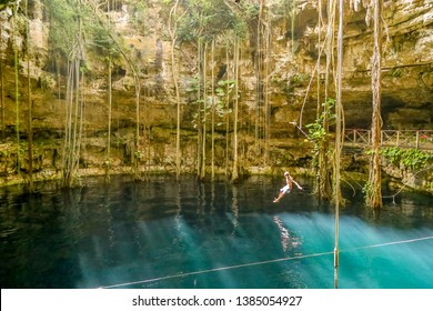 Yucatan, Mexico - October 30, 2014: A young man jumping in a cenote at San Lorenzo Oxman. Valladolid Cenotes. Yucatan Peninsula, Mexico