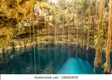 Yucatan, Mexico - October 30, 2014: A man swimming in a cenote at San Lorenzo Oxman. Valladolid Cenotes. Yucatan Peninsula, Mexico, America