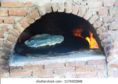 Yufka baked in the wood oven made of stone