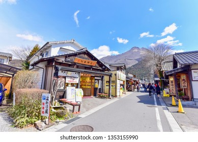 Yufuin, Japan - MARCH 14, 2019: Scenery of Local Shops and Mt. Yufu at Yufuin Village