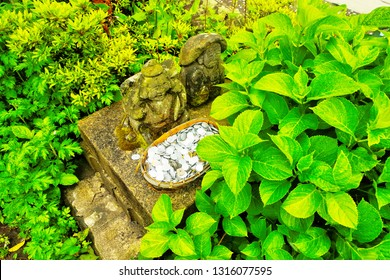 Yufuin ,Yufu ,Oita ,Japan - May 9th,2015 : Small rock sculptures in are Ta no Kami (Noushin) is god of good harvest and Ebisu Kami (Hiruko ,Webisu) is god of fishermen and luck in  Japanese believe