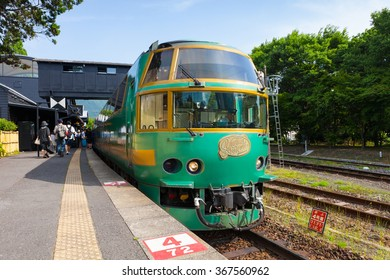 "YUFUIN,JAPAN - MAY 29: Tourist train called ""Yufuin no mori(Forest of Yufuin city)"" at Yufuin station on May 29 , 2014 in Yufuin city, Japan. Yufuin no mori is the most popular tourist train in Japan."