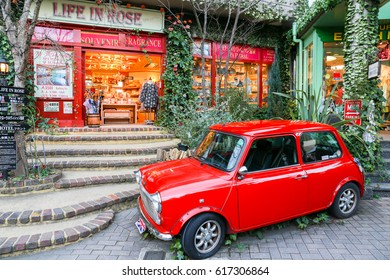 YUFUIN,OITA,JAPAN-DECEMBER 30,2015: Red car in the decorated antique English shops at Yufuin floral village