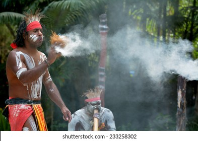 Yugambeh Aboriginal warrior demonstrate  fire making craft during Aboriginal culture show in Queensland, Australia.