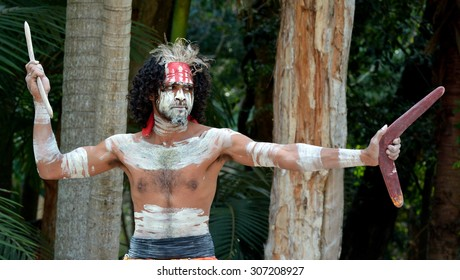 Yugambeh Aboriginal warrior throwing boomerang during cultural show in Queensland, Australia.