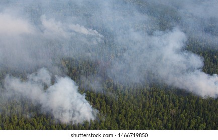 Yuganskiy Nature Reserve, Surgut district, Russia - July 20, 2013 - aerial view of massive low intensity wildfires in Siberian taiga