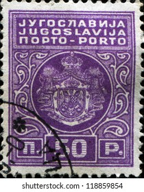YUGOSLAVIA - CIRCA 1931: A stamp printed in Yugoslavia shows  coat of arms of Yugoslavia, circa 1931