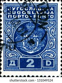 YUGOSLAVIA - CIRCA 1931: A stamp printed in Yugoslavia shows coat of arms of Kingdom Yugoslavia, circa 1931