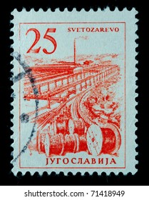 YUGOSLAVIA - CIRCA 1958: A stamp printed in Yugoslavia shows Plant and reels with cable, circa 1958
