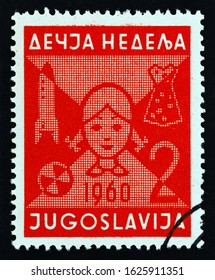 """YUGOSLAVIA - CIRCA 1960: A stamp printed in Yugoslavia from the """"Children's Week"""" issue shows Girl's head and toys, circa 1960."""