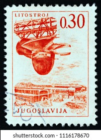 "YUGOSLAVIA - CIRCA 1966: A stamp printed in Yugoslavia from the ""Engineering & Architecture"" issue shows shipbuilding, circa 1966."