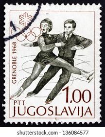 YUGOSLAVIA - CIRCA 1968: a stamp printed in the Yugoslavia shows Figure Skating Pair, Figure Skating, Pair, Winter Olympic sports, Grenoble 68, circa 1968