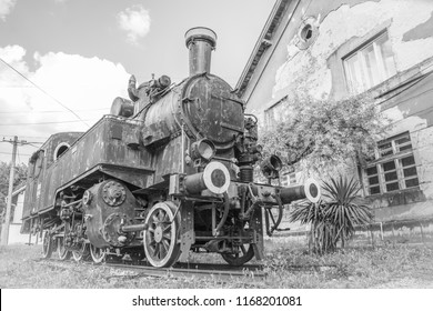 Yugoslavian train near old rail station in the city of Vrsac Serbia East Europe, black and white