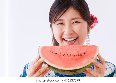 Yukata woman eating watermelon