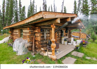 Yukon river, Yukon Territory, Alaska, USA. Wooden cabin in the remote wilderness of Alaska.