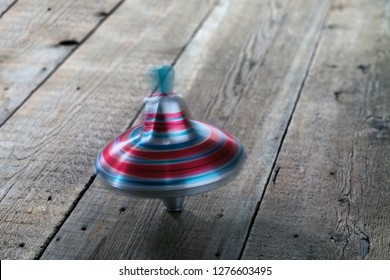 Yule toy spins on wooden floor