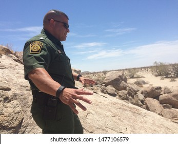 Yuma Sector, Ariz. / US - July 26, 2016: A Customs and Border Protection agent along the U.S.-Mexico border. 0408