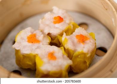 yumcha, dim sum in bamboo steamer, chinese cuisine