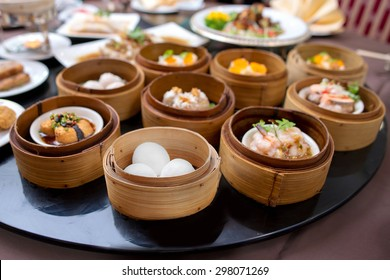yumcha,The Arrangement of various dim sum in bamboo steamer with chinese bun , pao , bao zi , steamed dumpling , shumai on table in chinese restaurant