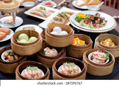 yumcha,The Arrangment of various dim sum in bamboo steamer with chinese bun , pao , bao zi , steamed dumpling , shumai on table in chinese restaurant
