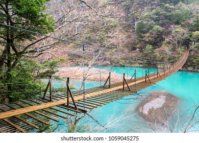 Yume no Tsuribashi Suspension bridge in the mountain with blue lagoon, Sumatakyou, Chubu, Shizuoka province, Japan