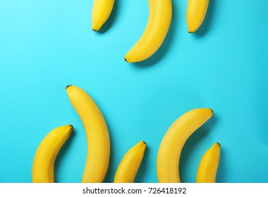 Yummy bananas on color background