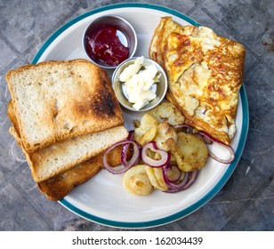 Yummy breakfast with omelette and potatoes