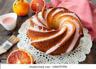 Yummy bundt cake with blood oranges and pink frosting
