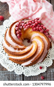 Yummy bundt cake with red currants and pink frosting