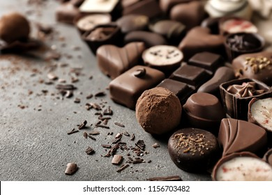 Yummy chocolate candies on grey background
