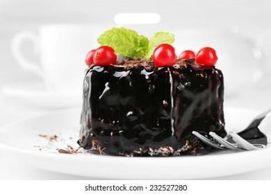 Yummy chocolate cupcake on table close-up
