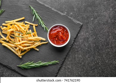 Yummy french fries on slate plate