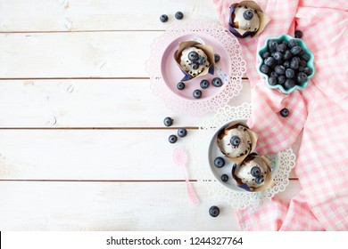Yummy little muffins with blueberries and sugar frosting